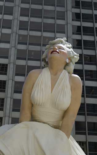 The face of Marilyn Monroe smiles on Seward Johnson's 26-foot-tall sculpture of Monroe, in her most famous wind-blown pose, on Michigan Ave. Friday, July 15, 2011 in Chicago.
